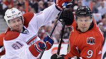Ottawa Senators' Milan Michalek , right, pushes back against Montreal Canadiens' Raphael Diaz during the first period of game four of first round NHL Stanley Cup playoff hockey in Ottawa on Tuesday, May 7, 2013. (Sean Kilpatrick/THE CANADIAN PRESS)