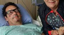 Pierre Karl Péladeau posted this photo on his public Facebook page following his bike accident. He is being tended to by Micheline Ouellet, the assistant chief nurse of the Centre Hospitalier Université de Sherbrooke.