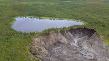 This small unnamed lake, shown in this undated University of Alberta handout photo, in the Northwest Territories is expected to burst through the rapidly shrinking land holding it in over the next few months and plunge 200 metres into the Mackenzie Valley. It's just one of a new wave of giant-sized permafrost slumps that are changing the territory's landscape on a scale not seen since the last Ice Age. (Scott Zolkos/THE CANADIAN PRESS)