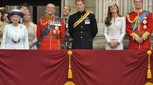 From left to right: The Queen, Prince Philip, Prince Harry, Prince William, the Duke of Cambridge and his wife, Catherine, the Duchess of Cambridge watch a fly-past as they stand on the balcony of Buckingham Palace in the annual Trooping of the Colour ceremony to celebrate the Queen's official birthday in central London, June 14, 2014. (TOBY MELVILLE/REUTERS)