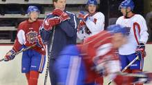 Montreal Canadiens' player development coach Patrice Brisebois takes part in a Hamilton Bulldogs practice in Hamilton, Ont., on Sunday, Oct.7, 2012. (Scott Gardner/THE CANADIAN PRESS)