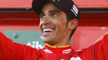 "Team Saxo Bank rider and leader of the race Alberto Contador of Spain celebrates after the 20th stage of the Tour of Spain ""La Vuelta"" cycling race between La Faisanera Golf and Bola del Mundo September 8, 2012. (JOSEBA ETXABURU/REUTERS)"
