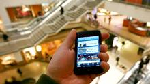 Just in time for the holiday season, the Toronto Eaton Centre has launched an iPhone application that allows users to access store promotions around the mall and post notes about shopping deals and updates to friends using Twitter and Facebook. (Fernando Morales/Fernando Morales/THE GLOBE AND M)