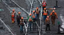 Canadian Pacific Rail workers inspect tracks at the company's Port Coquitlam yard east of Vancouver, on Tuesday Dec. 4, 2012. (DARRYL DYCK For The Globe and Mail)