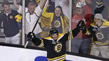 Boston Bruins left wing Loui Eriksson (21) celebrates his goal against Montreal Canadiens goalie Carey Price during the third period of Game 5 in the second-round of the Stanley Cup hockey playoff series in Boston, Saturday, May 10, 2014. (AP)