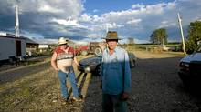 Rancher Carmen Langer and his brother-in-law Doug Dallyn walk towards the air testing shed that is being monitored by Alberta Environment at Mr. Langer's home. Residents in the area have been complaining of strong odours in the air which they say are affecting the health of their animals and family members. (Jimmy Jeong for The Globe and Mail/Jimmy Jeong for The Globe and Mail)