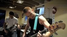 Flavio Branco, right, jams with friends at extremely loud decibel levels in a friend's basement in Mississauga, August 16 , 2010. (J.P. Moczulski/The Globe and Mail/J.P. Moczulski/The Globe and Mail)