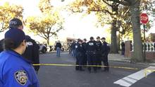 New York City Police Officers gather at a shooting scene in the Bronx borough or New York, Friday, Nov. 4, 2016. (Jennifer Peltz/AP)