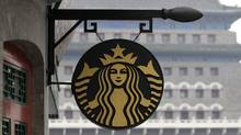 The Starbucks logo is seen outside its coffee store in front of Zhengyangmen Gate at Qianmen Commercial Street in central Beijing. (JASON LEE/REUTERS)