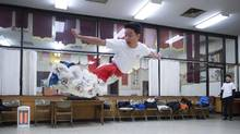 Angus Ing, 17, leaps through the air while practising a lion dance routine for the Chinese New Year Parade, in Vancouver, B.C. (DARRYL DYCK/THE CANADIAN PRESS)