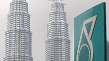 A Petronas logo is seen near its twin towers in Kuala Lumpur. (Lai Seng Sin/The Associated Press)