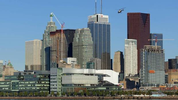 The new George Brown Waterfront Health Sciences Campus, with its sweeping white concrete lines, nestles in front of the downtown towers along the shore of Lake Ontario. The college campus is one of the important first steps toward revitalizing the Toronto waterfront. (Tom Arban Photography)