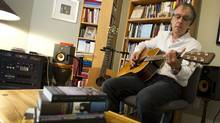 Songwriter and fiction writer Christopher Ward in his Toronto home office, where he spends most of his time writing, reading and creating his music (Kevin Van Paassen/The Globe and Mail)