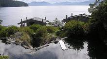 A hot spring filled with water is shown in Queen Charlotte, B.C. The hot water tap has been turned off at some idyllic springs on Hotspring Island after a powerful earthquake. (ANVIL COVE CHARTERS/THE CANADIAN PRESS)