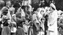 Queen Elizabeth II meets young Canadians, including Girl Guides and Brownies, during her visit to Osgoode Hall in Toronto on June 26, 1973. (Dennis Robinson/The Globe and Mail)
