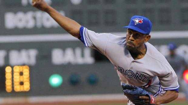 Toronto Blue Jays starting pitcher Ramon Ortiz delivers against the Boston Red Sox during the first inning of American League MLB baseball action at Fenway Park in Boston, Massachusetts May 10, 2013. (JESSICA RINALDI/Reuters)