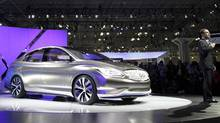 Carlos Ghosn, right, CEO of the Nissan-Renault Alliance, introduces the Infiniti LE concept at the New York International Auto Show. (Mark Lennihan/AP)