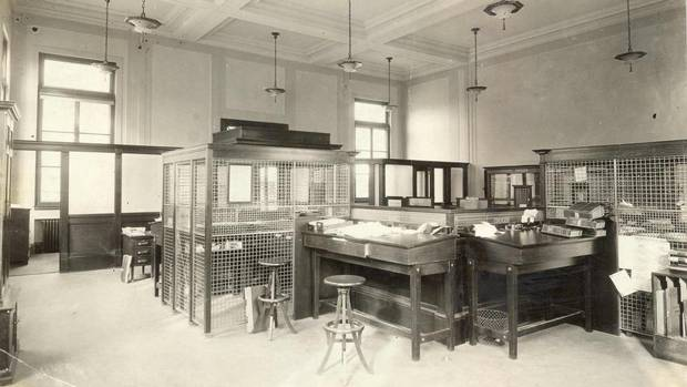 Canadian banks have undergone an evolution in design and function over the years. Here, the interior of a Royal Bank of Canada branch in Cambridge, Ont., in 1922. (Royal Bank of Canada)