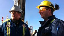 Walter Whitman, left, who is working on contract as the on-site representative for Shell Canada at its natural gas operation in northeastern British Columbia, and Rejean Tetrault, the operations manager. (Brent Jang/The Globe and Mail)