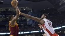 Toronto Raptors' Amir Johnson (right) reaches out in vain as Cleveland Cavaliers C.J Miles claims a defensive rebound during first half NBA basketball action in Toronto on Sunday March 10 , 2013. (CHRIS YOUNG/THE CANADIAN PRESS)