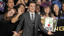 "Josh Hutcherson arrives at the world premiere of ""The Hunger Games"" on Monday March 12, 2012 in Los Angeles. (Chris Pizzello/AP)"