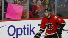 """A Calgary Flames' fan holds up a sign that reads """"a welcome back"""" in front of Cory Sarich during the third period of their NHL hockey game against the San Jose Sharks in Calgary, Alberta, January 20, 2013. (Todd Korol/Reuters)"""