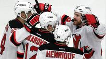 New Jersey Devils' David Clarkson, center right, celebrates with teammates after scoring a goal against the New York Rangers during the third period of Game 2 of an NHL hockey Stanley Cup Eastern Conference final playoff series, Wednesday, May 16, 2012, at New York's Madison Square Garden. (Julio Cortez/Julio Cortez/AP)