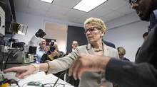 Ontario Premier Kathleen Wynne visits a lab at Ecobee, which produces WiFi-controlled domestic thermostats, on April 13, 2015, before an announcement that outlined a cap-and-trade deal with Quebec aimed at curbing greenhouse-gas emissions. (CHRIS YOUNG/THE CANADIAN PRESS)