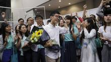 Former student-protest leader Nathan Law, centre, celebrates with his supporters after winning a seat at the legislative council elections. (Kin Cheung/The Associated Press)