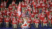 Canada's flagbearer wheelchair rugby player Garett Hickling during the Opening Ceremony for the 2012 Paralympics in London, Wednesday Aug. 29, 2012. (Kirsty Wigglesworth/AP)