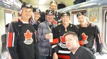 John Doyle along with some fellow Canadians on a train in Poland. (The Globe and Mail)