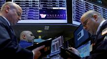 Traders gather at the post where Valeant Pharmaceuticals is traded on the floor of the New York Stock Exchange (NYSE) on Feb. 28. (BRENDAN MCDERMID/REUTERS)
