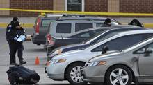 Toronto Police search for evidence in the west parking lot at Yorkdale Shopping Centre following a fatal shooting in Toronto, March 31, 2013. (J.P. MOCZULSKI for The Globe and Mail)
