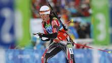 Canada's Megan Imrie leaves shooting range during the women's 4x6 km relay biathlon final at the Vancouver 2010 Winter Olympics in Whistler, British Columbia, February 23, 2010. (ISSEI KATO/REUTERS)
