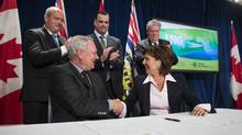 Premier Christy Clark and Pacific NorthWest LNG president Michael Culbert in Vancouver May 20, 2015 during a signing ceremony. (John Lehmann/The Globe and Mail)