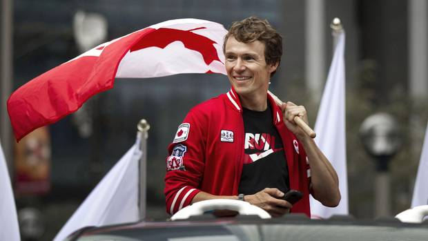 Olympian Simon Whitfield smiles during a parade celebrating Canada's Olympic athletes in Toronto. (Moe Doiron/The Globe and Mail)