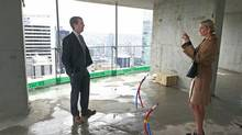 Donald Trump Jr., left, and his sister, Ivanka, visit the Trump International Hotel & Tower on Monday. The tower is slated for completion in 2016 and will be Vancouver's second-tallest building. (Jeff Vinnick/The Globe and Mail)