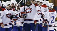 Montreal Canadiens defenseman P.K. Subban and his teammates celebrate after defeating the Boston Bruins in Game 7 (Elise Amendola/AP)