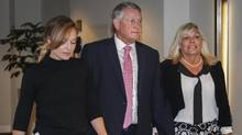 Federal Court Justice Robin Camp, centre, arrives with his wife, Maryann, and daughter Lauren-Lee at a Canadian Judicial Council inquiry in Calgary, Alta., on Sept. 6, 2016. (Jeff McIntosh/THE CANADIAN PRESS)