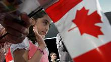 Iranian-born Negar Fakhraee, 8, takes the oath to become a Canadian citizen during a citizenship ceremony in Vancouver, B.C., on July 13, 2009. THE CANADIAN PRESS/Darryl Dyck (DARRYL DYCK/THE CANADIAN PRESS)