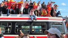 Spanish fans climb on top of a streetcar in Toronto on July 11, 2010 following Spain's victory over the Netherlands in the World Cup final. (PATRICK DELL/THE CANADIAN PRESS)