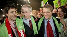 Newly elected Liberal Leader Stephane Dion, middle, is congratulated by Justin Trudeau and Gerard Kennedy after delivering his victory speech in Montreal on Dec. 2, 2006 (Simon Hayter/Getty Images)