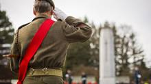 A veteran participates in Remembrance Day ceremonies at the cenotaph in the All Sappers' Memorial Park in Chilliwack, B.C., on Nov. 11, 2013. (JOHN LEHMANN/THE GLOBE AND MAIL)