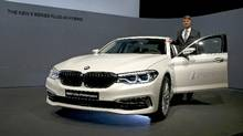 BMW Group chairman Harald Krueger with a BMW 530e iPerformance in Munich, Germany, on March 21, 2017. (MICHAEL DALDER/REUTERS)