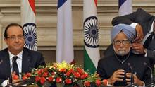 French President François Hollande and Indian Prime Minister Manmohan Singh at a signing ceremony in New Delhi on Feb. 14, 2013. (B MATHUR/REUTERS)