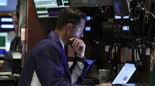A trader works on the floor of the New York Stock Exchange in New York July 13, 2012. (SHANNON STAPLETON/REUTERS)