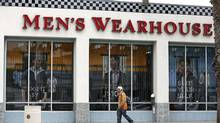 Men's Wearhouse will buy Jos. A. Bank for nearly 70 per cent more than Jos. A. Bank's stock price of last summer. (LUCY NICHOLSON/REUTERS)