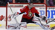 Ottawa Senators' goalie Craig Anderson makes a blocker save during the second period of their NHL game against the Buffalo Sabres in Ottawa February 5, 2013. (BLAIR GABLE/REUTERS)