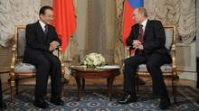 Happier times: Chinese Prime Minister Wen Jiabao, left, speaks with Russian counterpart Vladimir Putin at a summit of the Shanghai Co-operation Organization in St. Petersburg. (ALEXEY DRUZHININ/AFP/GETTY IMAGES/ALEXEY DRUZHININ/AFP/GETTY IMAGES)