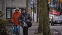 Rosemary Blomeyer, left, walks to her favourite breakfast restaurant with new friend Jean Collette. (JOHN LEHMANN/THE GLOBE AND MAIL)